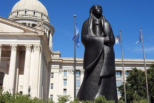 Oklahoma State Capitol with statue of Native American woman